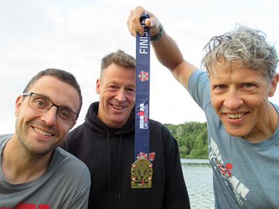 Ironmen Sean, Mike and Richard with an Ironman medal