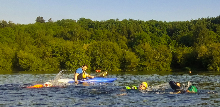 open water swimmers and kayak cover