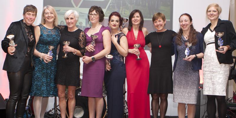 ladies team on stage at awards night