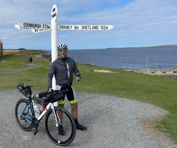 Mark at the John O Groats signpost
