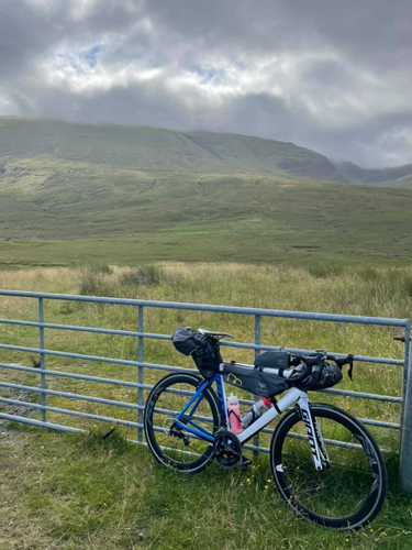 Mark's bike leaning against a date with mountains in the background
