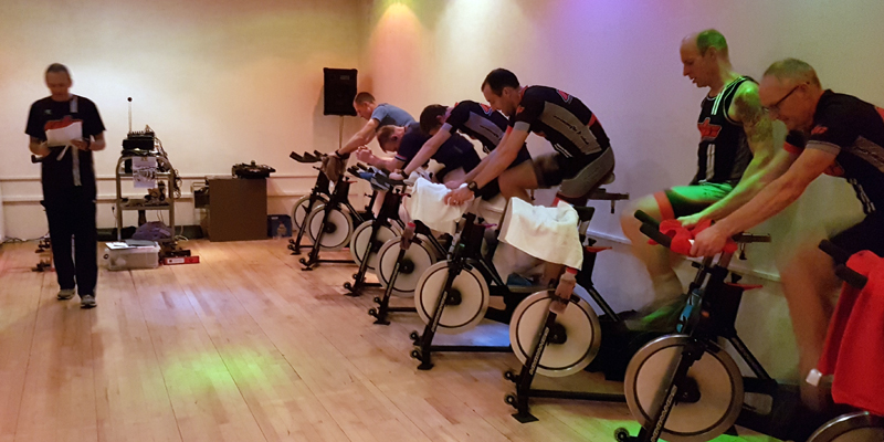 Cyclists on spin bikes